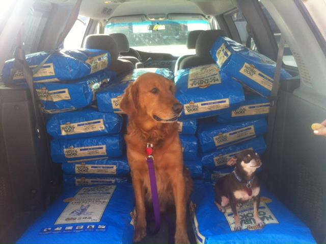 Sam and Sophie from Friends with Four Paws rescue loading up their truck with food from the Rescue Bank's distribution in Oklahoma. This group rescued 323 dogs last year!