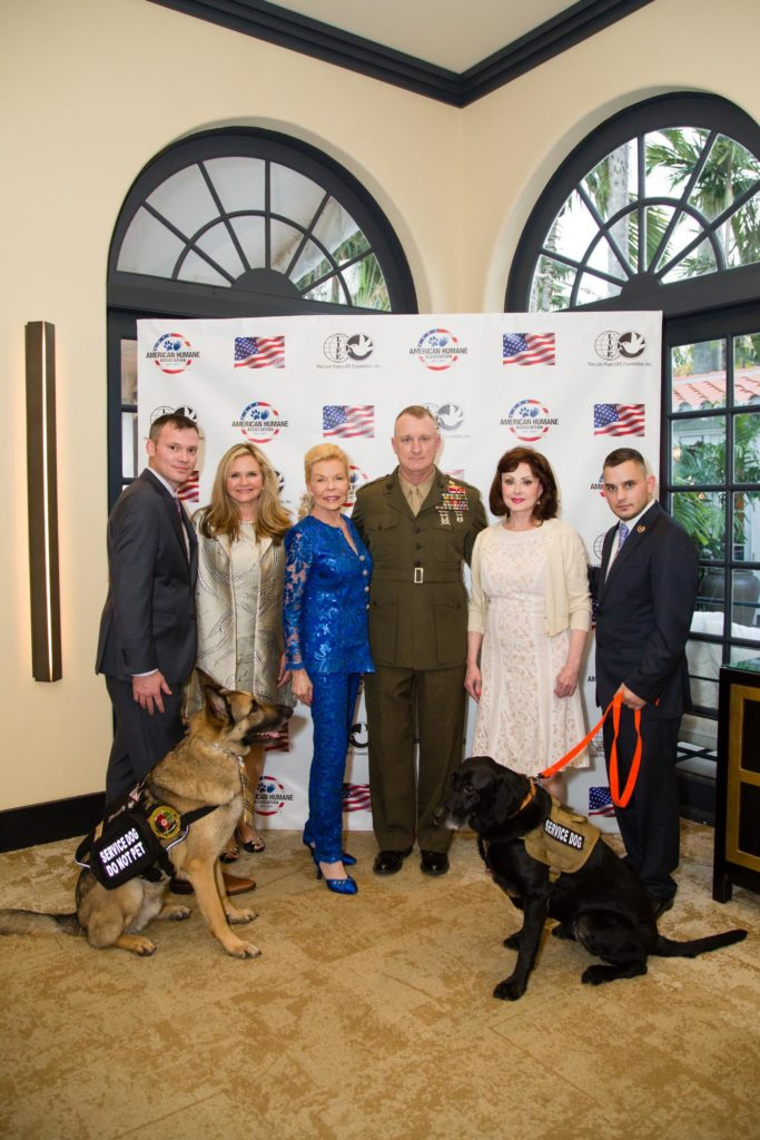 The other photo features (from left): Capt. Jason Haag, USMC (Ret.), American Humane Association's National Director of Military Affairs, and his service dog Axel; American Humane Association President and CEO Dr. Robin Ganzert; Mrs. Pope; Col. Campbell; Country music legend and American Humane Association board member Naomi Judd; and Lance Corporal Jeff DeYoung, USMC (Ret.) and his retired Military Working Dog Cena. Image source: Kim Zuccaro/CAPEHART