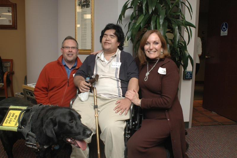 Nick and his service dog, Denver Image source: Disability Law Colorado)