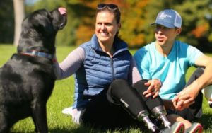Boston Marathon Bombing Survivors Pen Youngsters's Guide About Their Service Canine