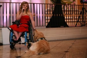 Erin Bischoff and Gauge at a fundraiser for service dogs.