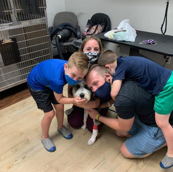 Family Hugging Bernadoodle