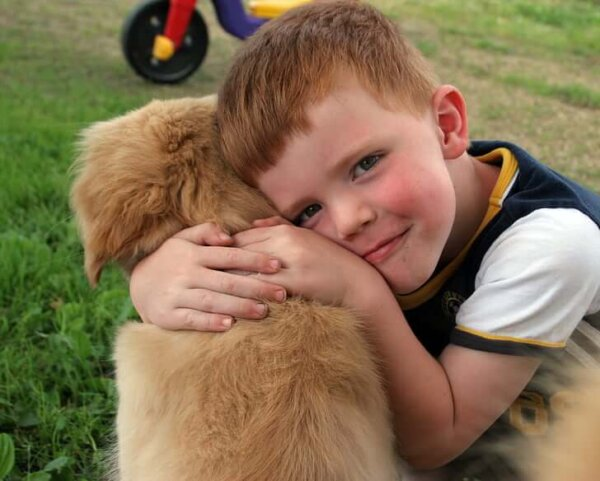 Boy Hugging Puppy