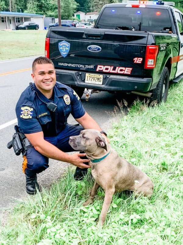 Officer with Rescued Dog