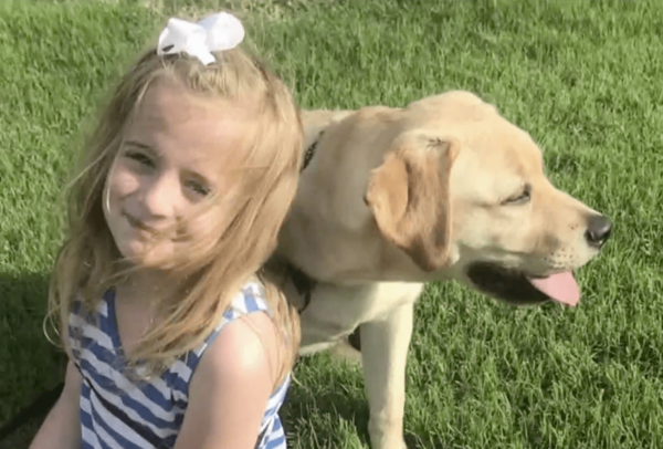 Girl with Labrador Retriever