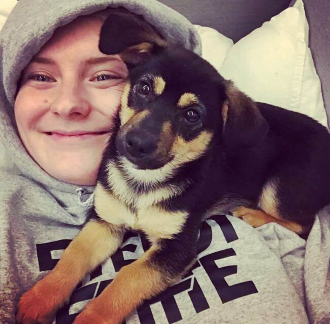 Puppy cuddling with woman