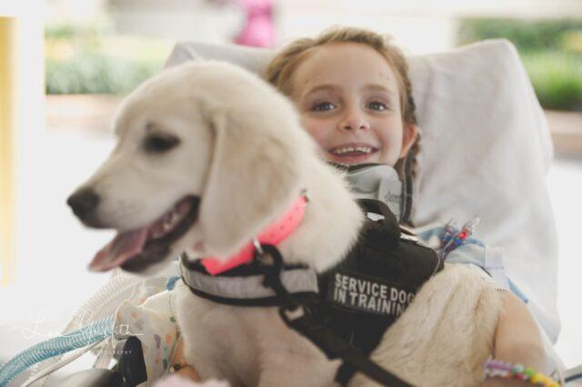 Girl Hugging Service Dog