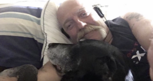 Man Grieving Dog Featured