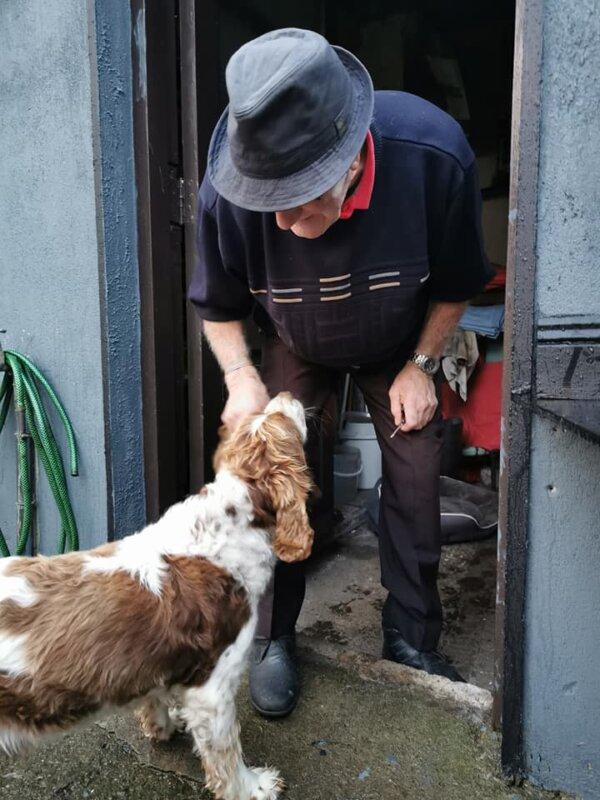 Man Petting Dog