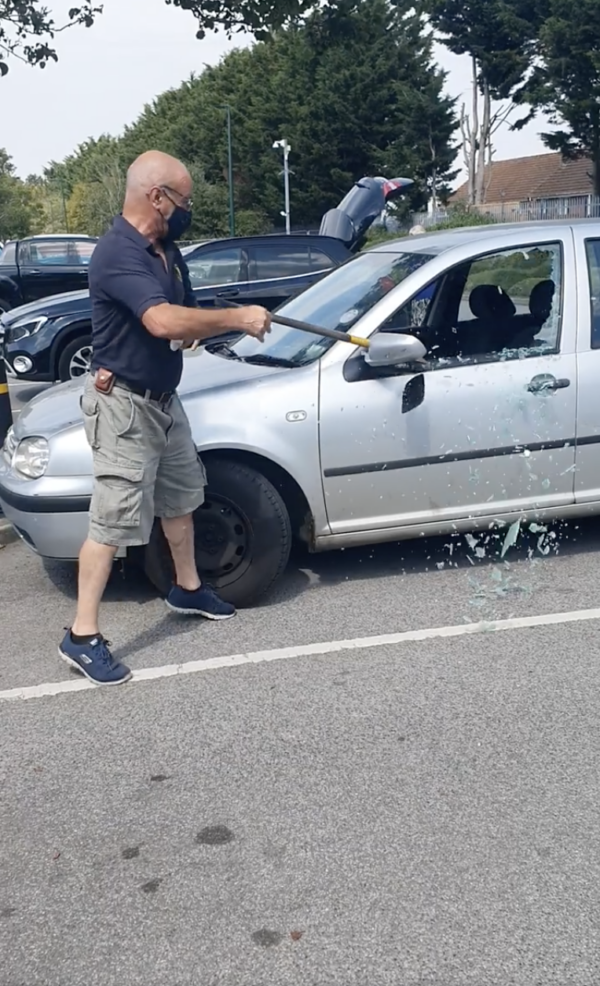 Man Breaks Car Window
