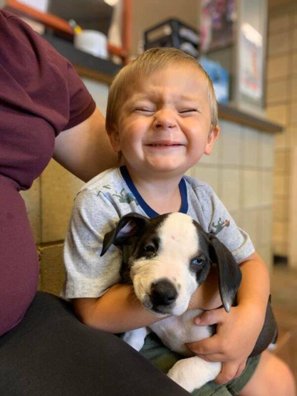 Happy Boy Hugging Puppy