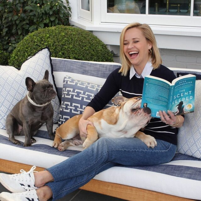 Reese Witherspoon Reading with Dogs