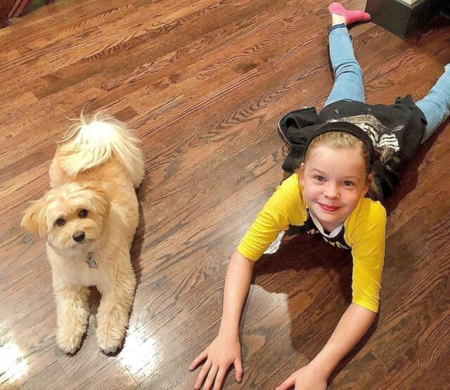 girl and rescue dog