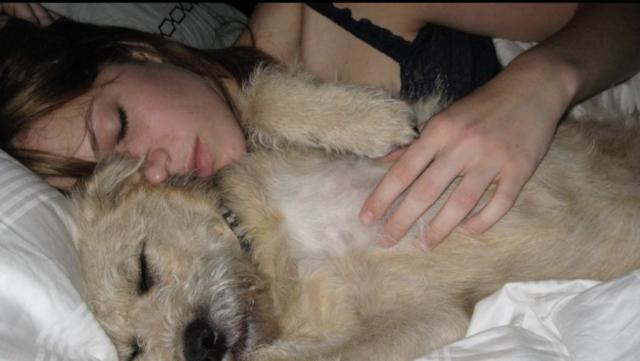 Mandy Moore Cuddling Dog