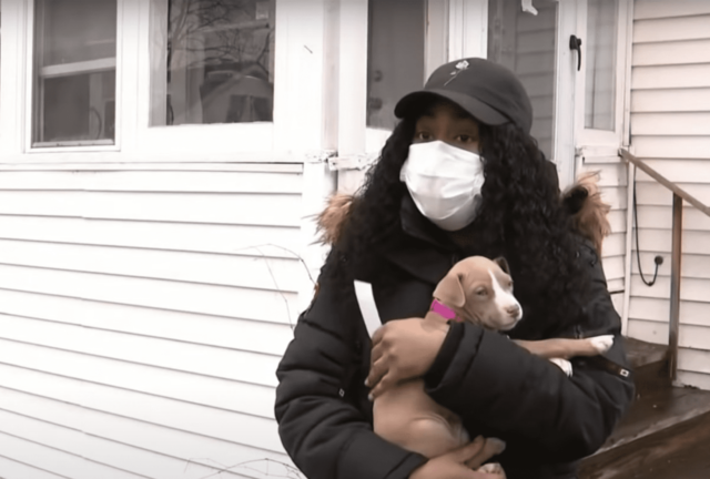 Woman Holding Her Stolen Puppy
