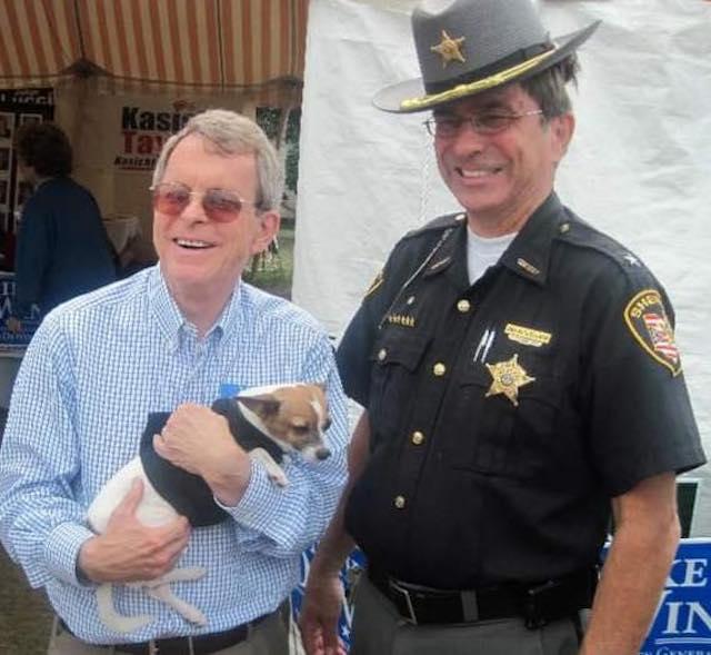 Mayor holding Midge
