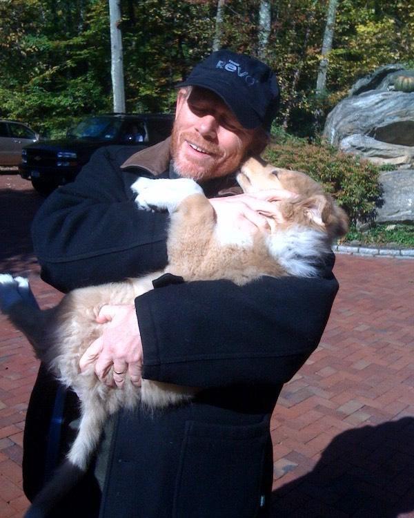 Ron Howard cuddling puppy