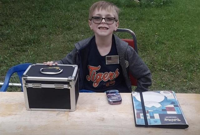 Boy selling Pokemon cards