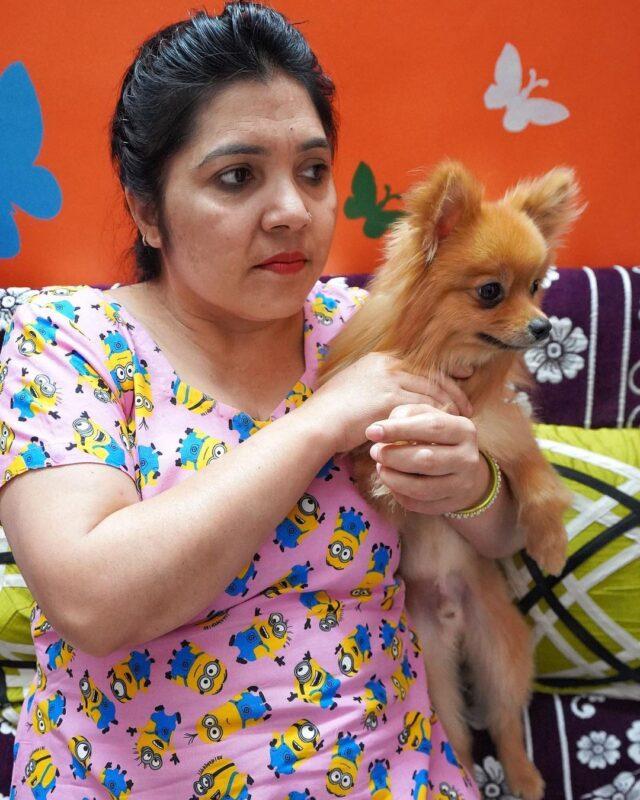 Mother holding Pomeranian