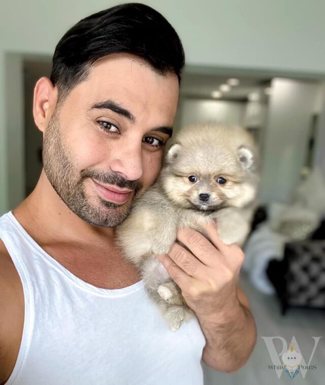 Singer and pomeranian puppy