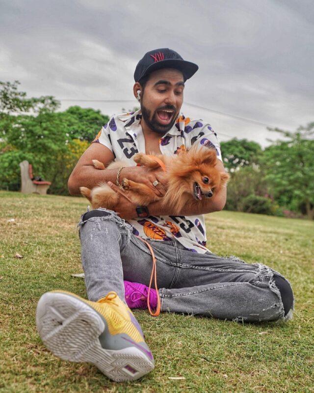 YouTuber cradling Pomeranian