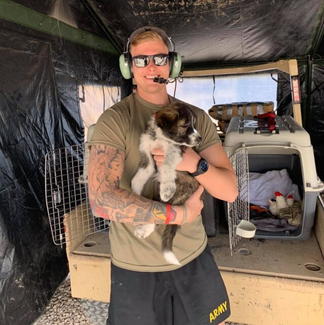 Soldier holding rescue puppy