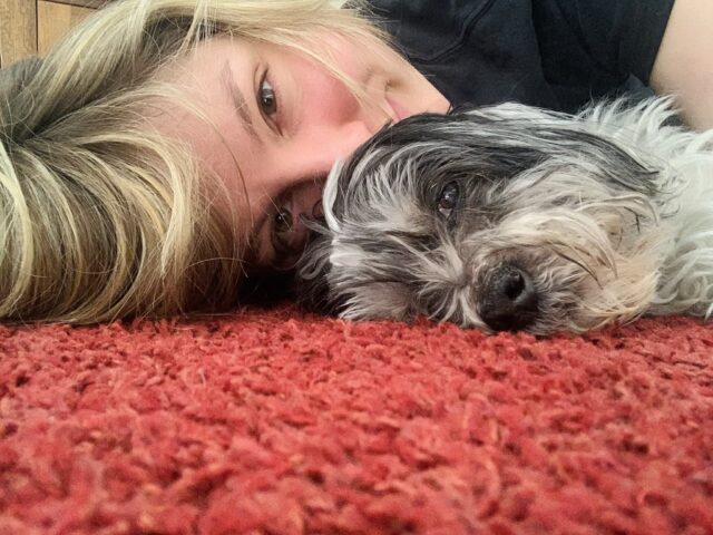 Molly laying with Scarlett