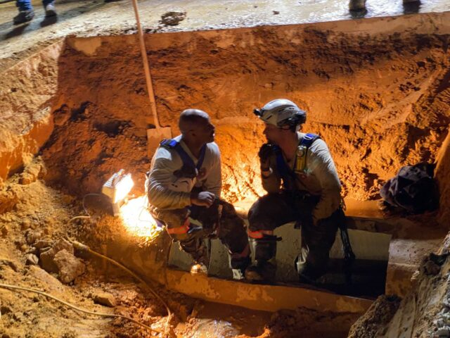 Rescue Crew at Storm Drain Pipe