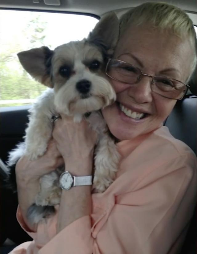 Woman hugging puppy