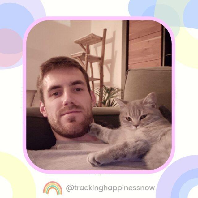 Man cuddling with cat
